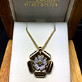 18ct White & Yellow gold flower pendant set with yellow and white diamonds