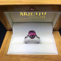 Platinum ring set with Oval Pink Tourmaline centre stone & Baguette cut diamond