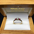 18ct Yellow gold three stone ring set with diamond and rubys